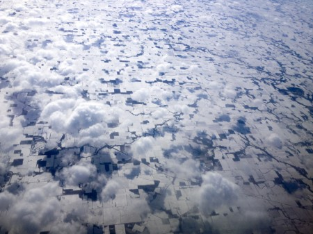 From my plane window I watched these beautiful snow and landscape patterns with cloud shadows unfold.