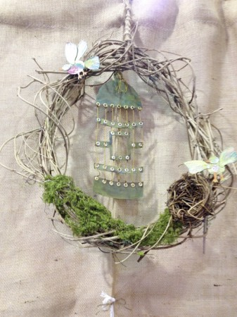 Large Lace-Up Bird Cage example displayed as part of a hand woven wisteria wreath with Totem Poppet Birds, bird nest and moss.