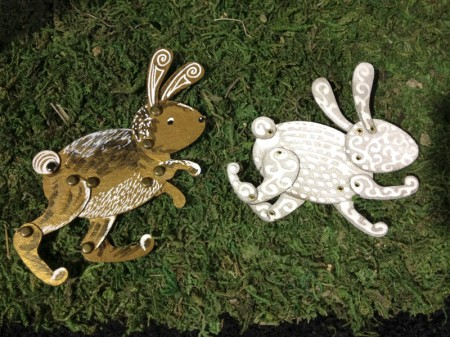 Totem Poppet Rabbits examples displayed on moss.