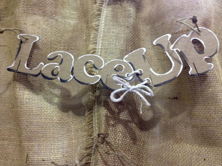 Lace-Up chipboard logo.