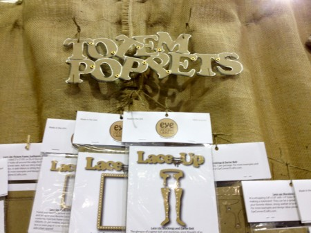Totem Poppet products display and chipboard logo.