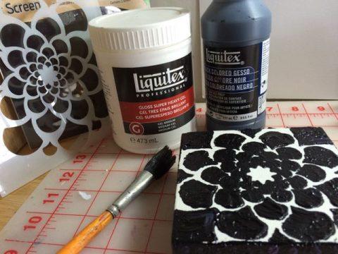 Mix black gesso and mat medium