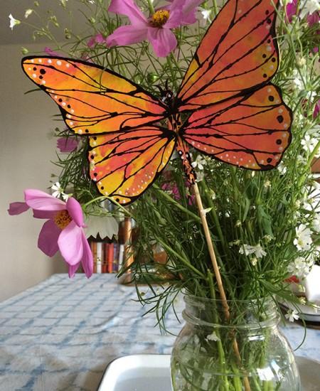 Totem Poppet Monarch in bouquet of wildflowers.